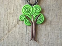 Tree Necklace Pendant from Swirls of Polymer Clay. $20.00, via Etsy.  Easy Idea!