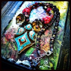 Turquoise & Coral Tibetan pendent with Brass, Pearl, Garnet, Ruby and Jasper. Created by Gypsy Lotus on Etsy, $110.00