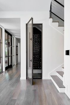 dallas Wine Cellar Doors with modern wine aerators and stoppers cellar contemporary floating vanity womb chair Home Wine Cellars, Wine Cellar Design, Wine Cellar Modern, Glass Wine Cellar, Wine Fridge, Under Stairs, Wine Storage, New Homes, House Design