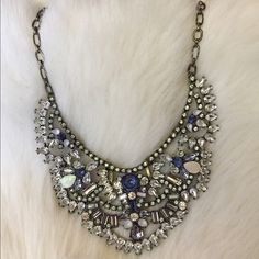 Like New Bauble Bar Statement Necklace Beautiful sparkling necklace. I bought this for my sisters wedding so I only wore it once. Blue stones, opal stones and rhinestones. Perfect piece for a party or special event. Excellent condition and fast shipping!  Bauble Bar Jewelry Necklaces