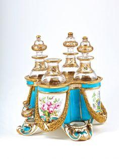 c1850 Exceptional Palais Royal Sevres porcelain scent tantalus, painted porcelain depicting four floral bouquets, bright gold detail, engrav...