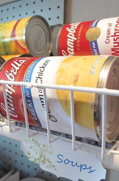 $1 Can Food Organization - I spied these nifty little wire baskets at the dollar store, grabbed a large and small can and they fit perfectly.#StorageSolutions #…