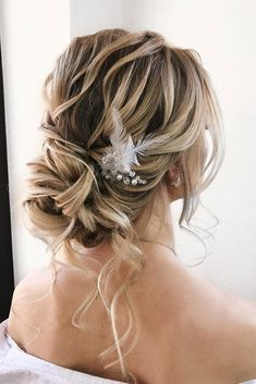 creative unique wedding hairstyles loose updo decorated with white feather sasha__esenina via instagram
