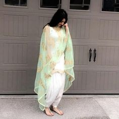 Image may contain: 1 person White Punjabi Suits, Indian Suits Punjabi, Punjabi Salwar Suits, Designer Punjabi Suits, Indian Attire, Salwar Kameez, Indian Wear, Indian Lehenga, White Suits