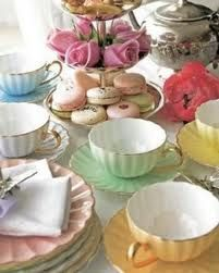 High Tea ~ I love the vintage pastel porcelain teacups and saucers mixed with the silver tea pot, pastry stand, tea spoons and crisp white linens.