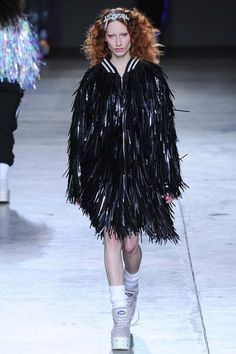 Ashish | Fall 2014 Ready-to-Wear Collection | Style.com I love this look because it combines the sporty letter men's jacket with girly glamorous flapper fringe. The shiny texture of the fringe gives the oversized jacket dimension