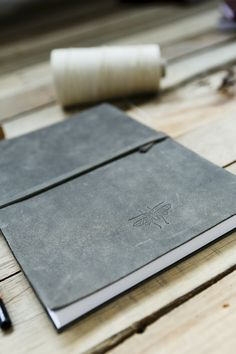 Leather journal, gray bound journal via Emili leather accessories   leather bags, wallets, satchels, passport covers and more   from Israel   Emili Yehezkel. Click on the image to see more!