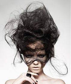 A long black straight wispy messy sculptured avant-garde hairstyle by Hooker & Young