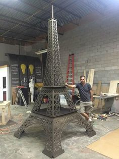 Imagine it 3D created, designed and carved an Eiffel Tower from MDF.  It was painted with Metallic Paint by Modern Masters - a mix of Pharaohs Gold and English Brown.   Event Design