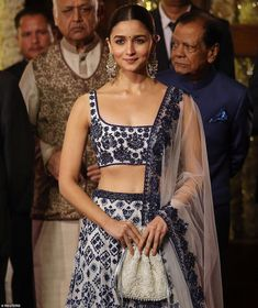 Actress and singer Alia Bhatt, who is known to be one of the highest-paid actresses in India, flashed a small smile at the cameras as she arrived in a stunning white and blue ensemble. Get it custom made for you. Ask us how - whatsapp - 918686692422 Mode Bollywood, Bollywood Fashion, Bollywood Stars, Indian Bridal Outfits, Indian Designer Outfits, Lehenga Designs, Saree Blouse Designs, Dress Indian Style, Indian Dresses