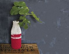 Felt maker, knitter and crocheter Stella Melgrati uses a milk bottle covered with chunky cotton rope in two contrasting colours to create a crochet vase.