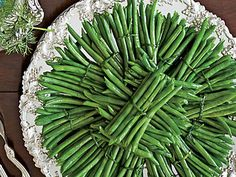 Green Beans with Hollandaise Sauce | Tie green beans in small bundles of five or six with chives that have been boiled for 5 seconds.