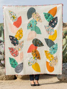Free Pattern | Hidden Garden Quilt | By Suzy Williams  The Hidden Garden Quilt Pattern by Suzy Quilts is your gateway to applique quilting!  Using the simple leaf motif (included free in pattern), Suzy shows you how to create a simple, yet classic arrangement.   Follow this link to get the pattern!  Follow this link to get the fabric!