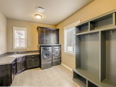 Erickson Farms home by JB Homes. Laundry room with cabinets