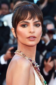 Emily Ratajkowski served up Audrey Hepburn vibes with her elegant updo and wispy bangs at Cannes Film Festival.