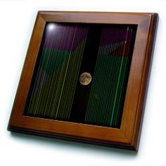 Yellow, Pink, Green, White and Gray Wire Making a Pattern with The Moon in Between Framed Tile
