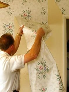 To remove wallpaper with household ingredients - score wallpaper, then combine hot water and fabric softener in a large spray bottle at a concentration of one to one. Tip: Mix the solution in small batches to keep the water as hot as possible.