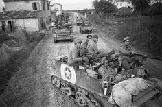 Bren carriers of the Maori Battalion drive through a village on the Adriatic Front in Italy, 19 Oct 1944.  [::SemAp FB :: || :: SemAp G+::]