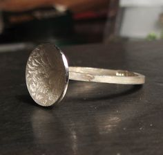 A cute little silver ring fabricated in sterling siver and adorned with a photo etched silver disk with a floral pattern.This thin ring can be combined and stacked with other bands for a fuller effect.The silver disk is domed.From the Volutes. Jewelry Rings, Fine Jewelry, Unique Jewelry, Bespoke Jewellery, Designer Jewellery, Thin Rings, Sterling Silver Jewelry, Silver Jewellery, Wedding Earrings
