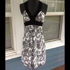 Pretty SPEECHLESS B&W Halter Dress SPEECHLESS halter Dress.  Lined and padded bodice cups.  real zipper closure.  Black and white cotton/spandex blend material.  Great condition. Speechless Dresses