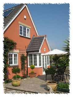 Orange Houses - Exterior House Colors | Orange house, Exterior house ...