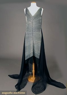 c1929 evening gown, rows of white beads, central row of diamante, handkerchief hem, possibly based on Erte pattern, France  augusta-auction.com