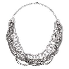 "Bold statement necklace with on trend layering look of chunks of chains in antique/burnished silver. Necklace has intertwined box chain, mesh chain, oval link chain, and interlocked chain.· Necklace: 24"" L with Lobster Claw clasp· Extender: 3 1/2"" L· Imported While supplies last #Bold #chain #Avon"