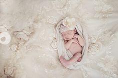 newborn laying on wedding dress :')
