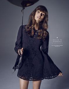 Grey background, dark dress
