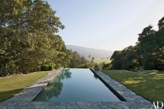 See How Bobby McAlpine Transformed a Napa Valley Home Into a Refined Haven | Architectural Digest Iron Wall Art, Summer Hill, Pool Coping, Mediterranean Homes, Lush Garden, Napa Valley, Sun Valley, Pool Houses, Architectural Digest