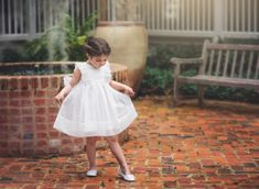 Trish Scully designs the best baby girl dresses, shoes, and sandals and you can buy girl clothes to give your baby girl a diva look with best kids clothing.