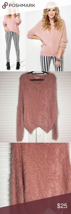 """NWOT Lulu's Cozy Rosy Fuzzy Pink Sweater NWOT Lulu's Cozy Rosy Fuzzy Pink Sweater  Size Medium Now you can take that cozy-day-on-the-couch feeling with you when you step out in the Cozy Rosy Fuzzy Pink Sweater! This luxuriously soft, eyelash knit sweater in an oversized fit has darling dolman sleeves, plus ribbed cuffs, hem, and v-neckline. Unlined. Model is wearing a size small. Small measures 21.5"""" long. 27"""" sleeve (from neckline). 28"""" waist (relaxed). 28"""" bust (relaxed). 70% Cotton, 30%…"""