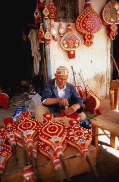 Morocco,Tinerhir,Berber craftsman making bellows