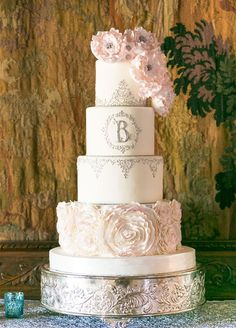 Soft pink blooms and fine silver piping make this wedding cake almost too lovely to eat.