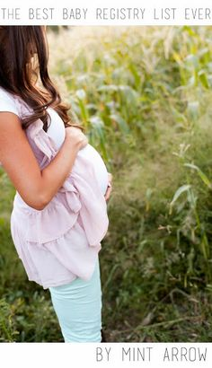 the BEST baby registry list ever! I love this photo. gorgeous blouse wrapping the belly
