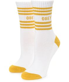 Adorn your feet with the Taylor crew socks from Obey. A white mid shin length sock accented with a golden yellow toe, heel and cuff detail features a soft padded heel and footbed for your fashion and comfort needs..