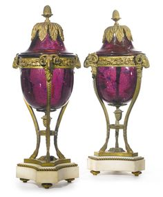 A pair of Louis XVI style gilt-bronze mounted amethyst colored glass urns<br>France, late 19th century | lot | Sotheby's