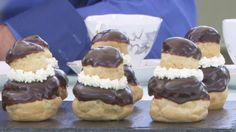 This choux buns recipe appears as the technical challenge in the Pastry episode of Season 2 of The Great British Baking Show on PBS Food. Choux pastry buns filled with crème patissiere and topped with chocolate ganache. British Baking Show Recipes, British Bake Off Recipes, Great British Bake Off, Mary Berry, Pastry Recipes, Baking Recipes, Logo Patisserie, Just Desserts, Dessert Recipes