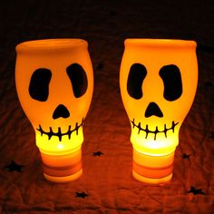 Dollar Store Crafts » Blog Archive » Lighted Skulls from Recycled Materials.  Milk bottle skulls (mini milk bottles, electrical tape, battery operated tea light)