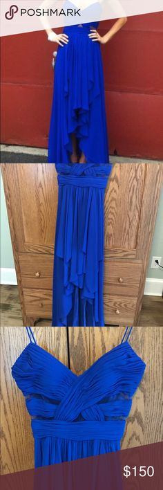 Flattering, beautiful sapphire blue gown by Cache. This high low gown is a beautiful color and is even more stunning in person. Hugs the body in all the right places and drapes elegantly! It photographs well and is very comfortable. Padded cups. Size 0. Has only been worn once and was dry cleaned immediately after. Cache Dresses Prom