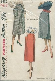 An original ca. 1951 Simplicity Pattern 3685.  Misses' Wraparound Skirt: The skirt is cut in three sections. Views 1 and 2 have a large patch pocket on front. Self fabric bias band trims View 1 which fastens with a button and snaps. Four buttons close skirt, Views 2 and 3. Saddle-stitching trims pocket, View 2. The lower edges of the skirt, View 3, are rounded.