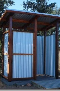 Corrugated metal sheets and western red cedar posts come together in this shower. - Corrugated metal sheets and western red cedar posts come together in this shower, designed by MyCar - Outdoor Pool Shower, Outdoor Shower Enclosure, Outdoor Toilet, Outdoor Baths, Outdoor Bathrooms, Outhouse Bathroom, Outside Showers, Diy Shower, Shower Ideas