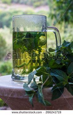 Mint tea in garden - stock photo