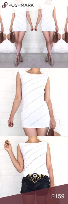 Moschino bodycon dress Super chic white stretchy dress by Moschino. Perfect for over a bathing suit or pull it up and wear it as a top. Moschino Dresses