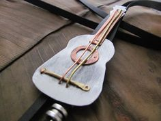 The Bolo Tie Guitar will be a real gift for your man especially if he's a…