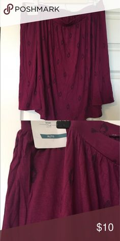 Mini skirt An elastic waist mini skirt. It is plum with designs on it, and it's brand new. It will look good with leggings or bare legs. Old Navy Skirts Mini