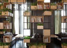 http://www.dezeen.com/2014/08/27/home-cafe-penda-metal-frame-modular-shelves-planters-china/