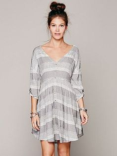 Free People Idle Wild Dress:  100% Rayon, Lined 100% Rayon, Cold wash; Love this!   Love the stripes & color