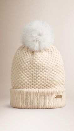 Burberry warm wool cashmere beanie with fur pom-pom Finished with a ribbed hem. Discover more accessories at Burberry.com
