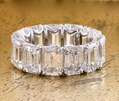 Available in white gold  Emerald-cut diamonds to suit this style: 13 diamonds total weight 13.70  carat  Number of stones and diamond weight will vary depending on the finger and  diamond size      Product No: DR10012